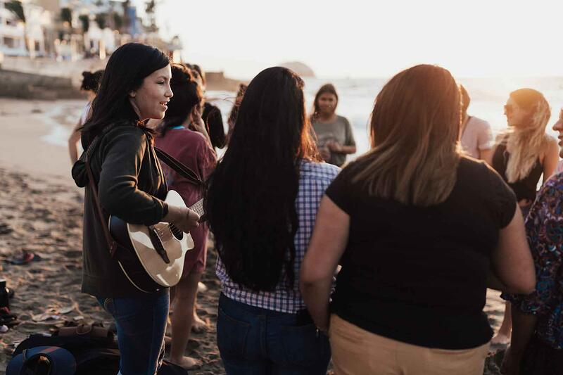 Group of YWAM missionaries enjoying a worship time on the beach in Mazatlan, Mexico