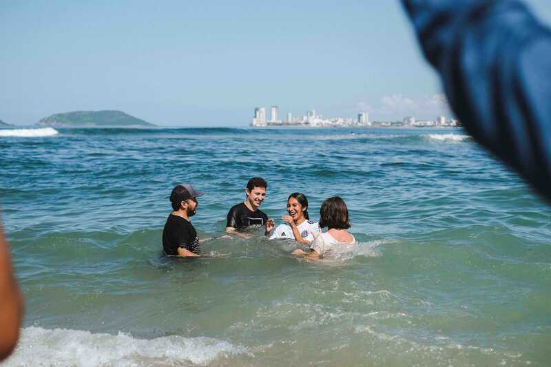 YWAM student gets baptized in the ocean in front of YWAM Mazatlan