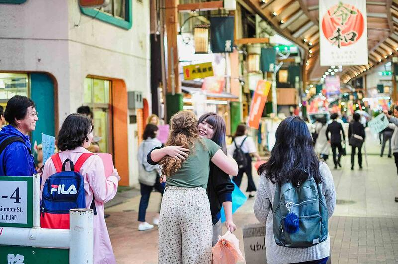 YWAM missionaries doing street ministry by giving free hugs in Japan