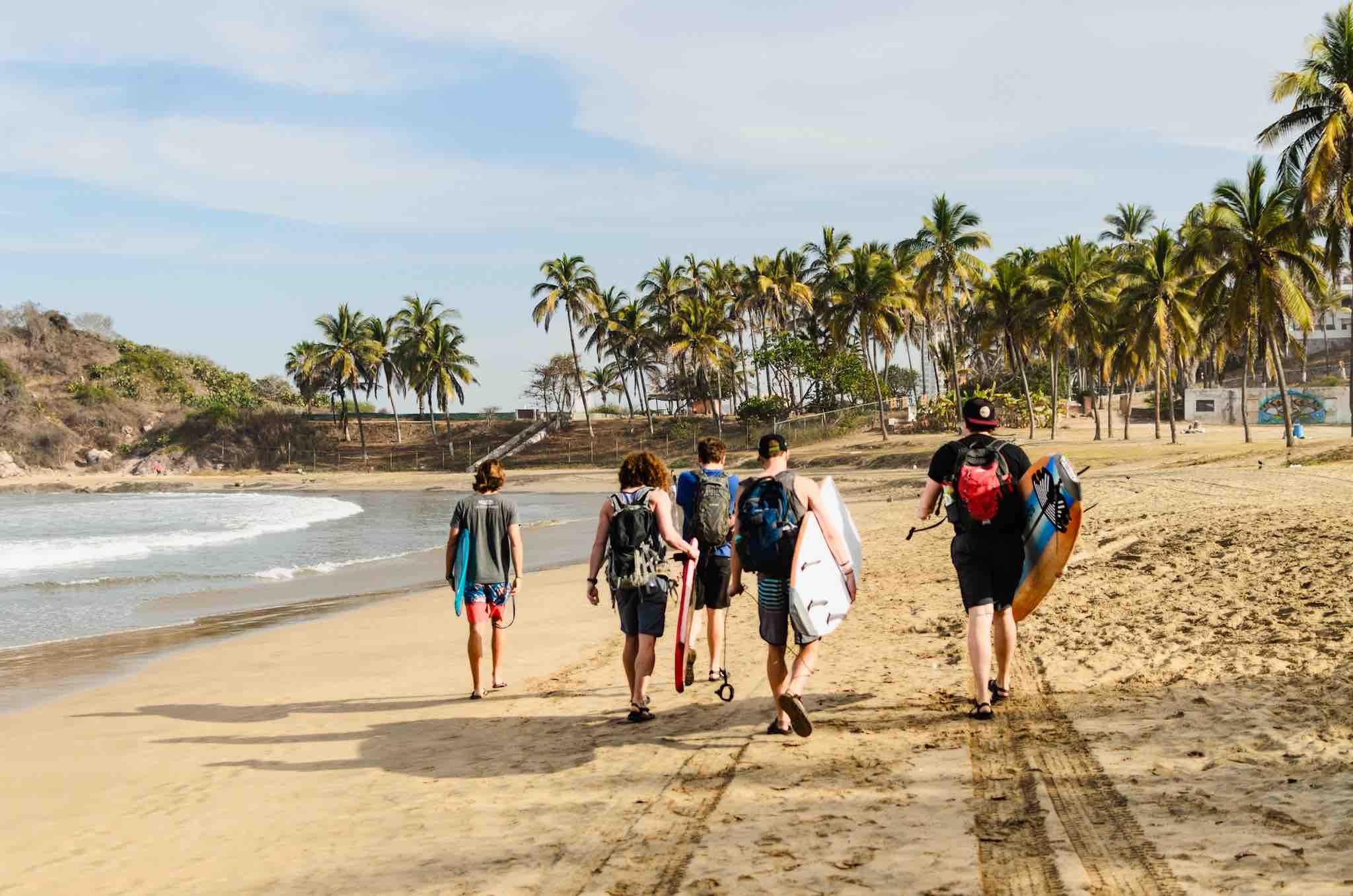 YWAM surfer missionaries walking down the beach in Mazatlan, Mexico