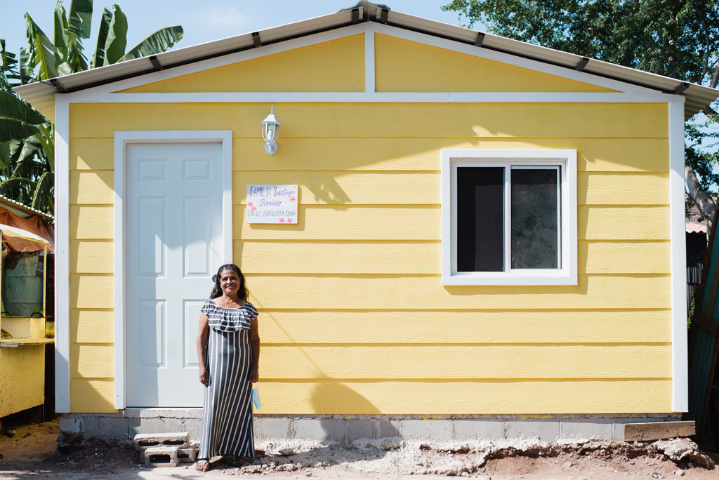Homes of Hope recipient standing in front of her new home in Mazatlan, Mexico
