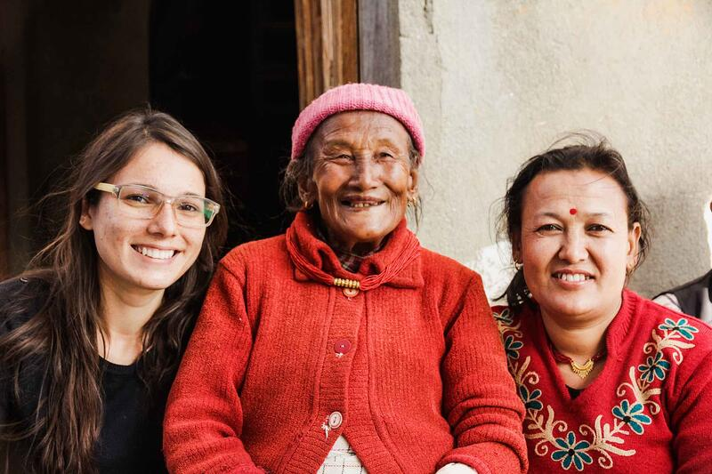 YWAM missionaries and an elderly Nepali woman smiling for a photo while on outreach in Nepal with YWAM Mazatlan