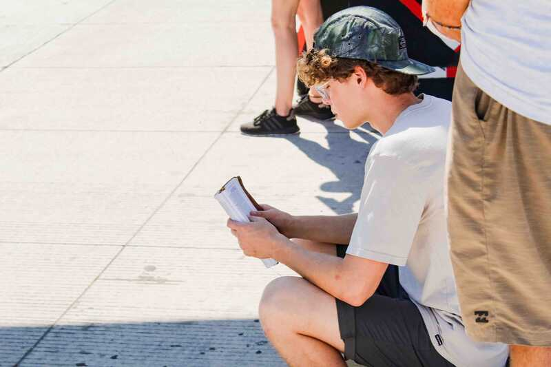 Young YWAM missionary reading the Bible on the streets of Mazatlan