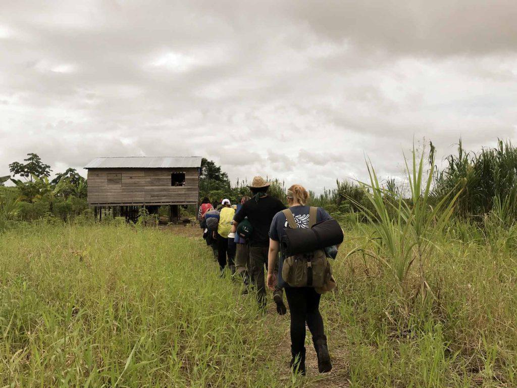 YWAM missionaries hiking through a field en route to their next outreach location