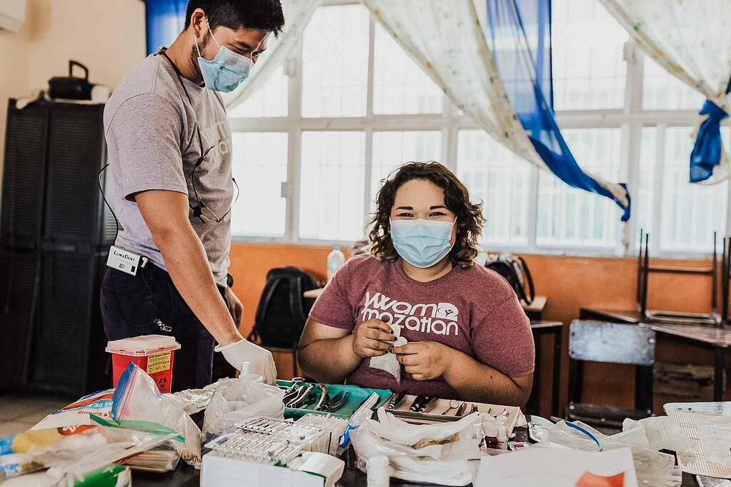 YWAM missionary volunteers prepare dental equipment to serve locals in Mazatlan, Mexico in a mobile medical brigade