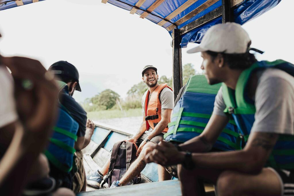 YWAM missionary smiling at his team members while traveling to their next outreach location