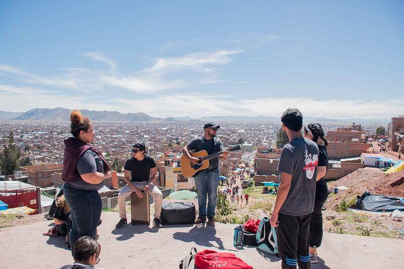 YWAM missionaries having a worship time while on outreach in South America