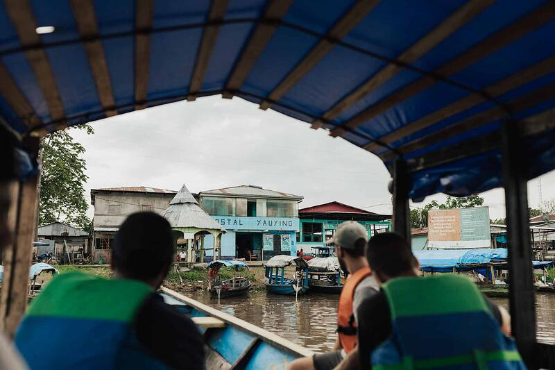 YWAM outreach team members arriving to a village on a small boat